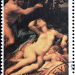 Постер, плакат: BURYATIA CIRCA 1990: A stamp printed in Buryatia shows picture of Correggio Venus and Cupid with a Satyr circa 1990