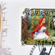 Foto de Stock  : JERSEY - CIRC2005: stamp printed in Jersey shows Little Red Riding Hood and Wolf, circ2005