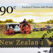 NEW ZEALAND - CIRCA 2004: A stamp printed in New Zealand dedicated to historic farm equipment, shows Fordson F tractor with Plough, circa 2004 — Stock Photo