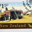 NEW ZEALAND - CIRCA 2004: A stamp printed in New Zealand dedicated to historic farm equipment, shows Threshing Mill, circa 2004 — Foto de Stock