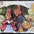 UNITED KINGDOM - CIRCA 1993: A stamp printed in Great Britain shows Peter Rabbot and Mrs Rabbit (The Tale of Peter Rabbit), circa 1993 — Stock Photo