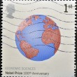 Stock Photo: UNITED KINGDOM - CIRC2001: stamp printed in Great Britain shows image of Earth commemorates 100th anniversary of Nobel Prize for Economics, circ2001