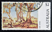 AUSTRALIA - CIRCA 1974: a stamp printed in Australia shows Red Gums of the Far North, Painting by Hans Heysen, circa 1974 — Stock Photo