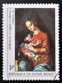 GUINEA - CIRCA 1984: A stamp printed in Republic of Guinea Bissau shows draw by artist Morales - Virgin and child, circa 1984 — Stock Photo