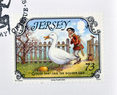 JERSEY - CIRCA 2005: A stamp printed in Jersey shows Goose that laid the golden egg, circa 2005 — Stockfoto