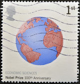 UNITED KINGDOM - CIRCA 2001: a stamp printed in Great Britain shows image of Earth commemorates the 100th anniversary of the Nobel Prize for Economics, circa 2001 — 图库照片