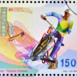 PORTUGAL - CIRCA 1997: A stamp printed in Portugal dedicated to extreme sports, shows Mountain biking, circa 1997 — Stock Photo
