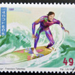 PORTUGAL - CIRCA 1997: A stamp printed in Portugal dedicated to extreme sports, shows surfing, circa 1997 — Stock Photo
