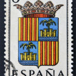 Stok fotoğraf: SPAIN - CIRC1965: stamp printed in Spain dedicated to Arms of Provincial Capitals shows Balearics, circ1965.