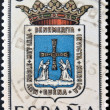 SPAIN - CIRCA 1965: A stamp printed in Spain dedicated to Arms of Provincial Capitals shows Oviedo, circa 1965.  — ストック写真