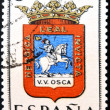 SPAIN - CIRCA 1965: A stamp printed in Spain dedicated to Arms of Provincial Capitals shows Huesca, circa 1965. — Stok fotoğraf