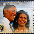 Stock Photo: UGAND- CIRC2000: stamp printed in Ugandshows Barack Hussein Obamand Michelle Obama, circ2009