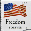 Stock Photo: UNITED STATES OF AMERIC- CIRC2012: stamp printed in USshows image of USFlag, Freedom, USforever, circ2012