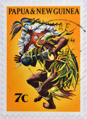 PAPUA AND NEW GUIENA - CIRCA 1971: A stamp printed in Papua shows tribal dance man, circa 1971 — Stock Photo