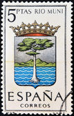 SPAIN - CIRCA 1965: A stamp printed in Spain dedicated to Arms of Provincial Capitals shows Rio Muni, circa 1965. — Stock Photo