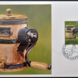 Stock Photo: LIECHTENSTEIN - CIRC1980: stamp printed in Liechtenstein dedicated to old alpine dairy farming implements shows Butter Churn, circ1980