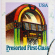 UNITED STATES OF AMERICA - CIRCA 1995: A stamp printed in USA shows jukebox, presorted first class, circa 1995 — Stock Photo