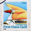 UNITED STATES OF AMERICA - CIRCA 1996: A stamp printed in USA shows auto tail fin, presorted first class card, circa 1996 — Stock Photo