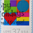 UNITED STATES OF AMERICA- CIRCA 2002: A stamp printed in USA shows hearts, love, circa 2002 — Stock Photo