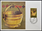 LIECHTENSTEIN - CIRCA 1980: A stamp printed in Liechtenstein dedicated to old alpine dairy farming implements shows Milking Pail, circa 1980 — Stock Photo