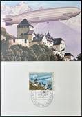 LIECHTENSTEIN - CIRCA 1979: Stamp printed in Liechtenstein shows Zeppelin over Vaduz Castle, circa 1979 — Stockfoto