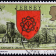 JERSEY - CIRCA 1976: a stamp printed in Jersey shows Arms and St. Saviour s Church, circa 1976  — Stock Photo