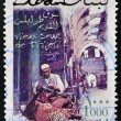 LEBANON - CIRCA 2000: A stamp printed in Lebanon shows View of street in Tripoli with traditional craftsman, circa 2000 — Stock Photo #29134341