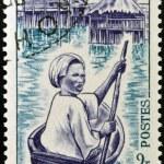 DAHOMEY - CIRCA 1963: stamp printed in Dahomey, shows Ganvie Woman in Canoe, circa 1963 — Stock Photo #29385119