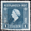 Stock Photo: DUTCH EAST INDIES - CIRC1945: stamp printed in Netherlands Indies shows image of Queen Wilhelminof Netherlands, circ1945