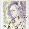 ITALY - CIRCA 2002: A stamp printed in Italy shows detail of Mary Magdalene in The Feast of Herod and Salome's dance designed by Filippo Lippi, circa 2002  — Stock Photo