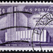 UNITED STATES OF AMERICA - CIRCA 1956: A stamp printed in USA shows New York Coliseum & Columbus Monument, FIPEX, New York City, circa 1956 — Stock Photo