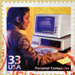 UNITED STATES OF AMERICA - CIRCA 2000: a stamp printed in USA showing an image of a woman using an old computer, circa 2000. — Stock Photo