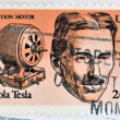 UNITED STATES OF AMERICA - CIRCA 1983: A stamp printed in USA shows Induction motor and portrait of Nicola Tesla, inventor, electrical engineer and mechanical, circa 1983 — Stock Photo