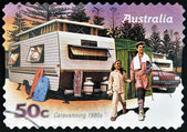 AUSTRALIA - CIRCA 2007: A stamp printed in australia shows Family enjoying a caravan of the 80s, caravanning 1980s, circa 2007 — Stock Photo