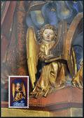 Liechtenstein - circa 1982: eine briefmarke gedruckt in liechtenstein gewidmet skulpturen von chur kathedrale zeigt engel spielt die orgel, ca. 1982 — Stockfoto