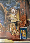 LIECHTENSTEIN - CIRCA 1982: A stamp printed in Liechtenstein dedicated to Sculptures from Chur Cathedral shows Angel playing the Lute, circa 1982 — Stock Photo