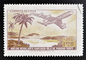 CHILE - CIRCA 1972: A stamp printed in Chile commemorates the establishment of regular flights from Santiago de Chile to Easter Island and Tahiti, circa 1972 — Stock Photo