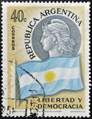 ARGENTINA - CIRCA 1958: A stamp printed in Argentina shows flag and woman, freedom and democracy, circa 1958 — Stock Photo