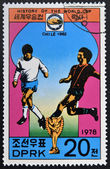 "KOREA - CIRCA 1978: A Stamp printed in North Korea shows the Soccer players, Cup and Glob with the inscription ""Chile, 1962"", from the series ""History of World Cup Football Championship"", circa 1978 — Foto Stock"