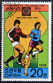 "KOREA - CIRCA 1978: A Stamp printed in North Korea shows the Soccer players, Cup and Glob with the inscription ""Switzerland, 1954"", from the series ""History of World Cup Football Championship"" — Foto Stock"
