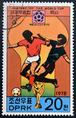 "KOREA - CIRCA 1978: A Stamp printed in North Korea shows the Soccer players, Cup and Glob with the inscription ""Mexico, 1970"", from the series ""History of World Cup Football Championship"", circa 1978 — Foto Stock"