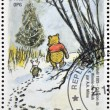 Постер, плакат: GUINEA CIRCA 1998: a stamp printed in Republic of Guinea commemorates the creation of Winnie the Pooh by Milne circa 1998