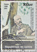GUINEA - CIRCA 1998: a stamp printed in Republic of Guinea in commemoration of the death of Nicola Antonio di Tocco (pioneer of the music industry), circa 1998. — Stock Photo