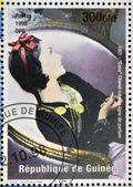 GUINEA - CIRCA 1998: a stamp printed in Republic of Guinea commemorating Coco Chanel created her perfume line, circa 1998. — Stock Photo