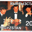 Stock Photo: KIRZIGUISTAN - CIRC2001: stamp printed in Kirziguistshows Beatles and BriEpstein, circ2001
