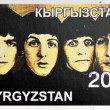KIRZIGUISTAN - CIRCA 2001: stamp printed in Kirziguistan shows the Beatles, circa 2001 — Stok fotoğraf