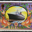 GUERNSEY - CIRCA 1999: A stamp printed in Guernsey shows Queen Elizabeth 2 (Liner), circa 1999 — Stock Photo