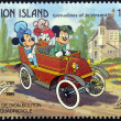 ST. VINCENT GRENADINES - UNION ISLAND - CIRCA 1989: A stamp printed in St. Vincent shows Mickey Mouse, Minnie Mouse and Daisy Duck, 1891 De Dion Bouton Quadricycle, circa 1989 — Stock Photo