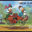 ST. VINCENT GRENADINES - UNION ISLAND - CIRCA 1989: A stamp printed in St. Vincent shows Donald Duck and Daisy Duck, 1890-1891 Panhard-Levassor, circa 1989  — Stock Photo