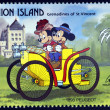 ST. VINCENT GRENADINES - UNION ISLAND - CIRCA 1989: A stamp printed in St. Vincent shows Mickey Mouse and Minnie Mouse, 1893 Peugeot, circa 1989  — Stock Photo